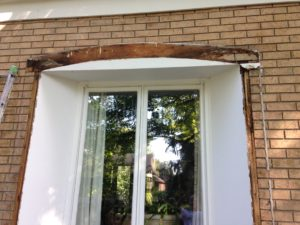 Damaged wood on windows and doors are in need of professional painting