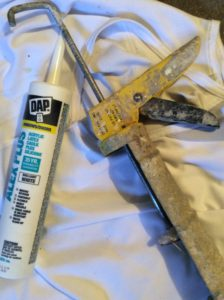 painters use caulking for professional house painting results on trim around windows doors baseboards and trim